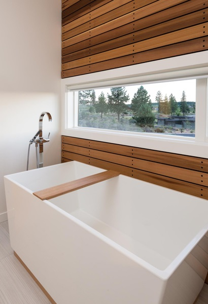 modern soaking tub with a view